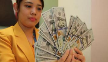 Foto Dolar AS Melemah Jelang Pernyataan Federal Reserve