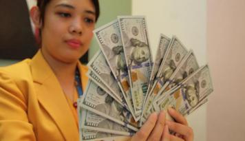 Foto Dolar AS Bervariasi Jelang Pidato Yellen
