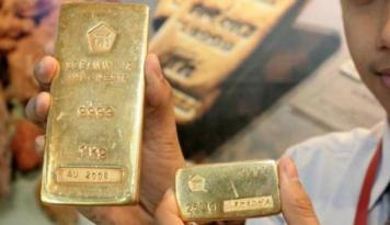 Foto Emas Turun Akibat Penguatan Dolar AS
