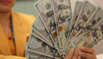 Foto Dolar Bervariasi Setelah Debat Perdana Calon Presiden AS